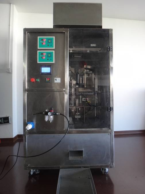 Four station tea bag vacuum packaging machine
